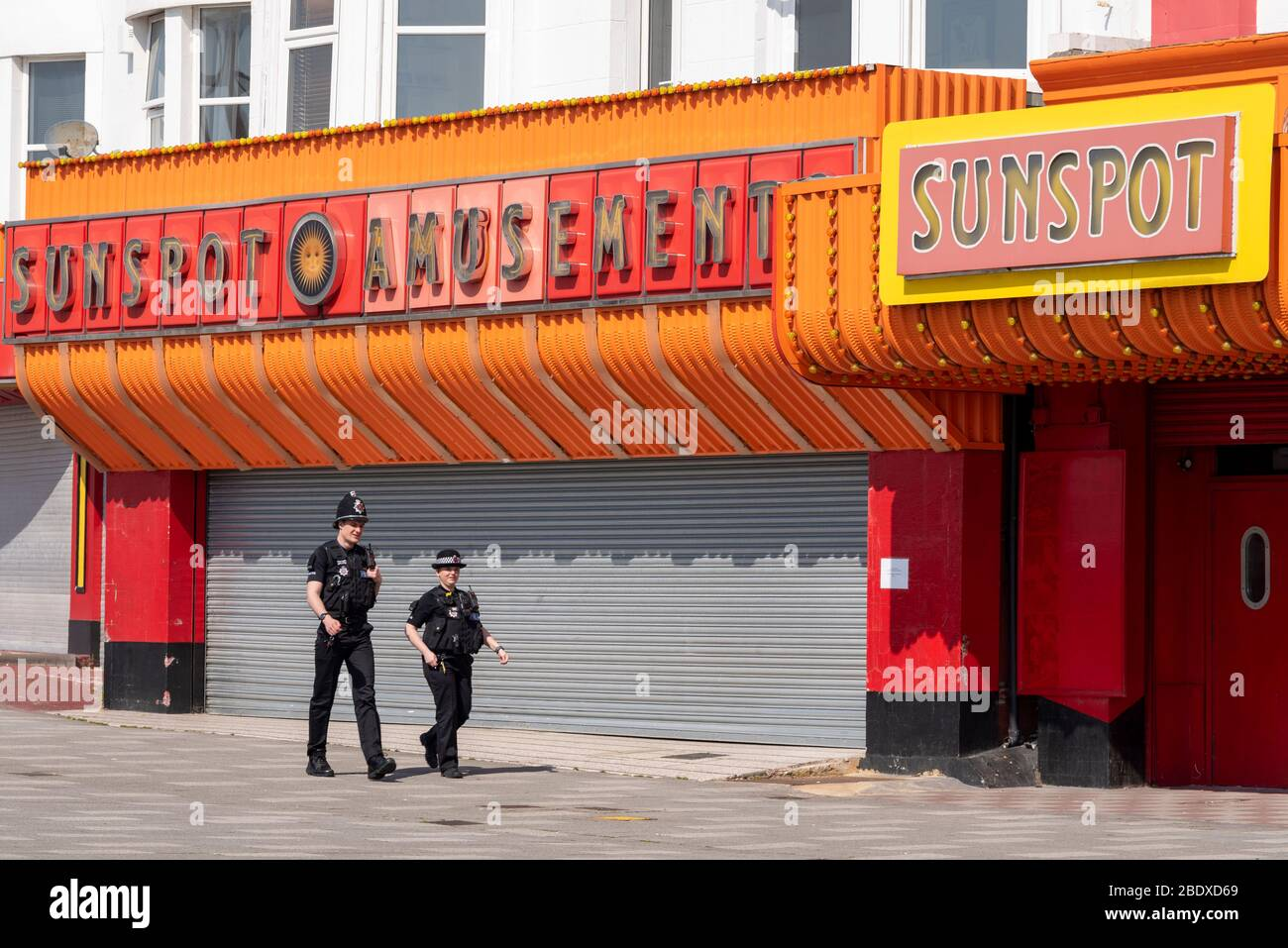 southend-on-sea-essex-uk-10th-apr-2020-on-the-first-day-of-the-easter-weekend-during-the-covid-19-coronavirus-lockdown-period-people-are-making-use-of-southend-on-seas-seafront-to-enjoy-the-sunny-and-warm-weather-police-and-civil-enforcement-officers-are-patrolling-the-areas-with-car-parks-and-businesses-closed-police-officers-walking-past-closed-amusement-arcade-business-2BDXD69.jpg