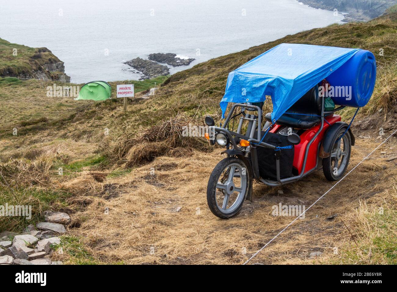electric-mobility-scooter-with-a-tent-on-cliff-top-ireland-west-cork-2BE6Y8R.jpg