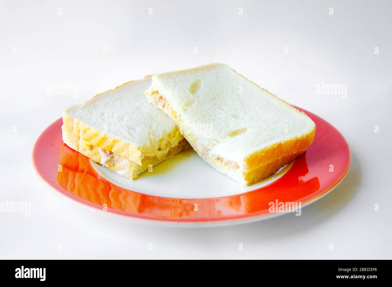 a-homemade-tuna-and-mayonnaise-sandwich-on-a-plate-shot-against-a-while-background-2BED3F8.jpg