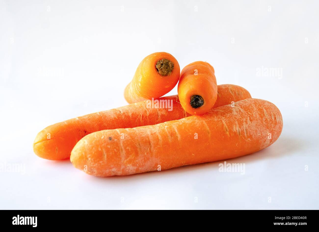 raw-carrots-shot-against-a-white-background-2BED40R.jpg