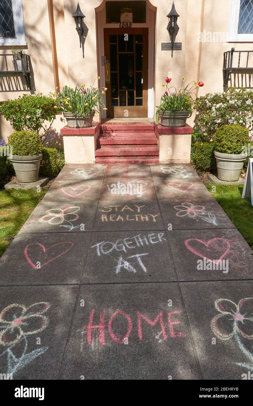 vancouver-canada-11-april-2020-childrens-colorful-chalk-writing-remind-passers-by-to-stay-healty-at-home-during-the-covd-19-pandemic-2BEHRYB.jpg