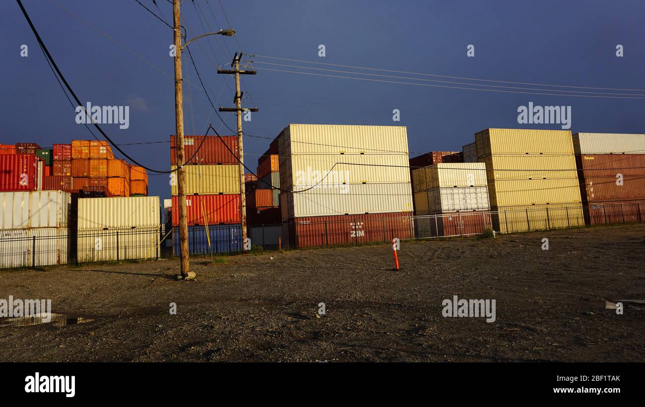 International shipping container terminal. Stacks of intermodal containers used for global trade and cargo commerce. Outer Harbor, Port of Oakland. Stock Photo