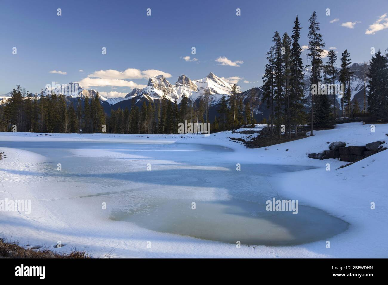frozen-lake-and-distant-snowy-rocky-moun