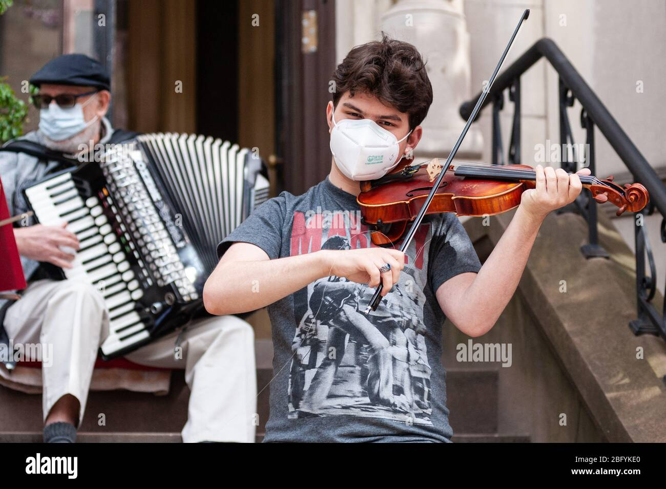Brooklyn, United States. 19th Apr, 2020. 18-year-old Park Sloper Lev Garfein plays the violin brightening the day for neighbors and passerby's in the Park Slope neighborhood of Brooklyn, New York, during the COVID-19 pandemic on April 19, 2020. (Photo by Gabriele Holtermann-Gorden/Pacific Press) Credit: Pacific Press Agency/Alamy Live News Stock Photo