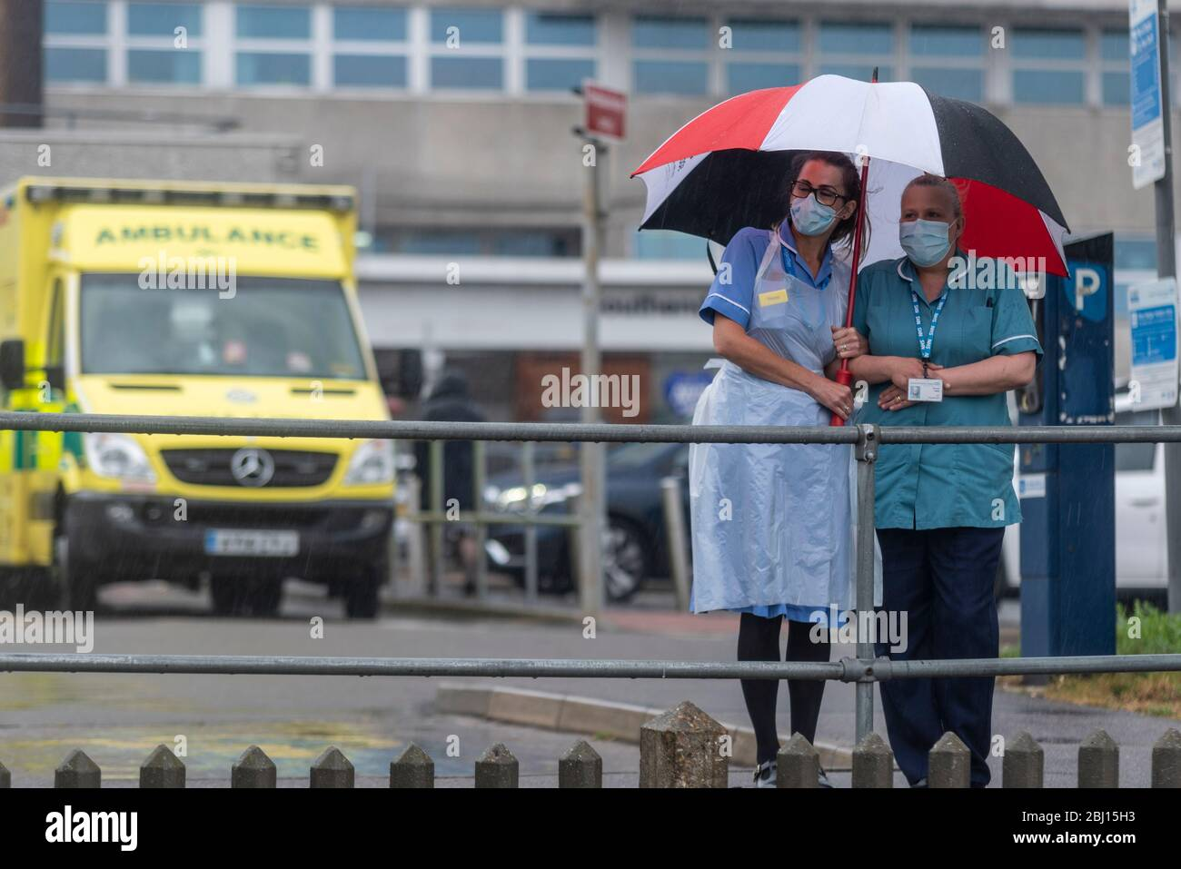 southend-university-hospital-southend-on-sea-essex-uk-28th-apr-2020-on-international-workers-memorial-day-a-one-minutes-silence-took-place-at-11am-to-remember-the-health-and-social-care-and-other-key-workers-that-have-died-as-a-result-of-the-covid-19-coronavirus-pandemic-pairs-of-shoes-have-been-placed-on-the-green-outside-southends-hospital-as-a-visual-reminder-of-the-more-than-one-hundred-frontline-staff-who-have-lost-their-lives-including-a-number-from-southend-2BJ15H3.jpg