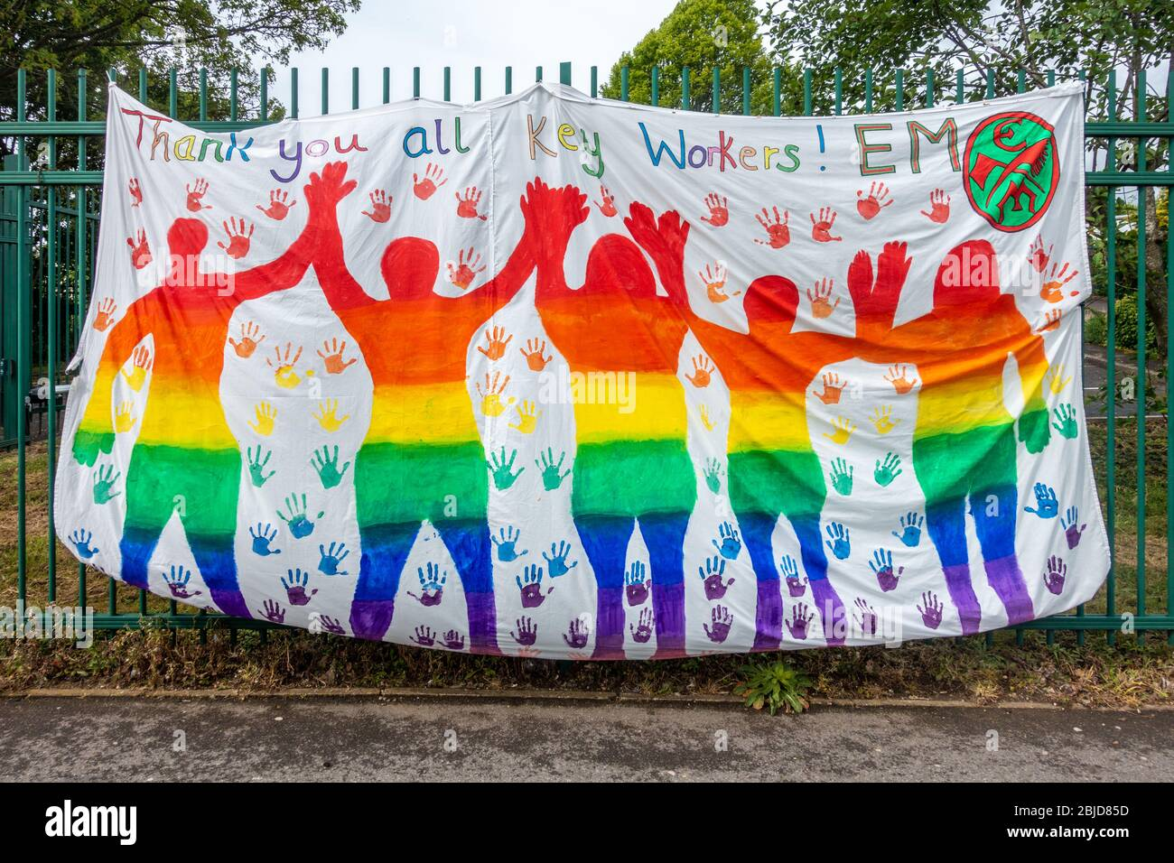 a-large-colourful-banner-attached-to-the-railings-of-a-primary-school-in-reading-uk-thanks-key-workers-for-working-during-the-coronavirus-pandemic-2BJD85D.jpg