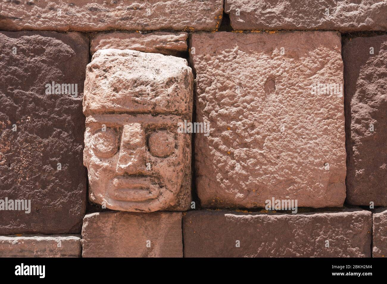detail of a sculpture of a head carved in relief at the pre-Columbian archaeological site in Tiwanaku, Bolivia Stock Photo