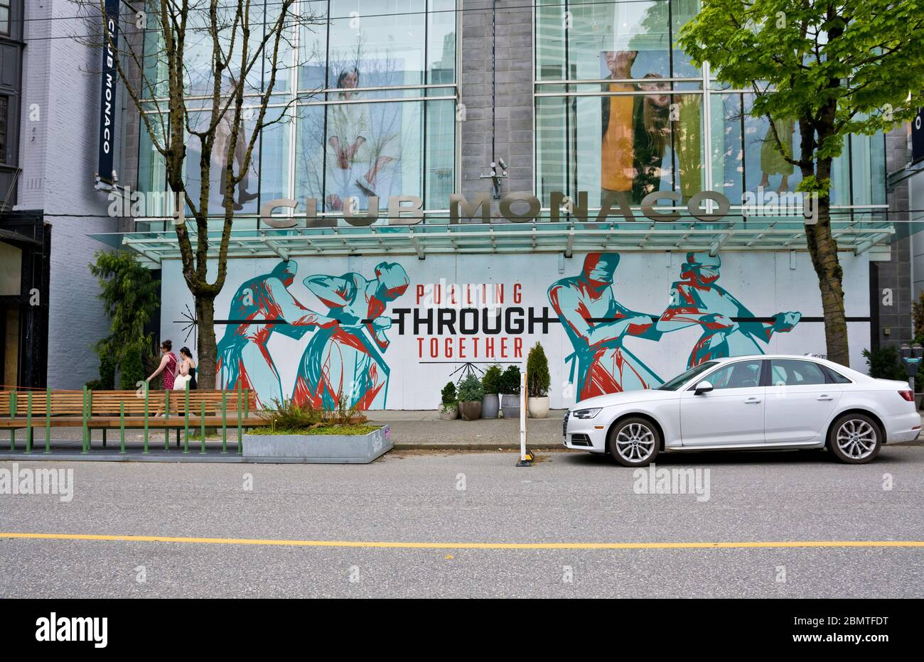 vancouver-bc-may-9-2020-mural-on-a-boarded-up-store-on-robson-street-with-a-positive-message-pulling-through-together-during-the-pandemic-2BMTFDT.jpg