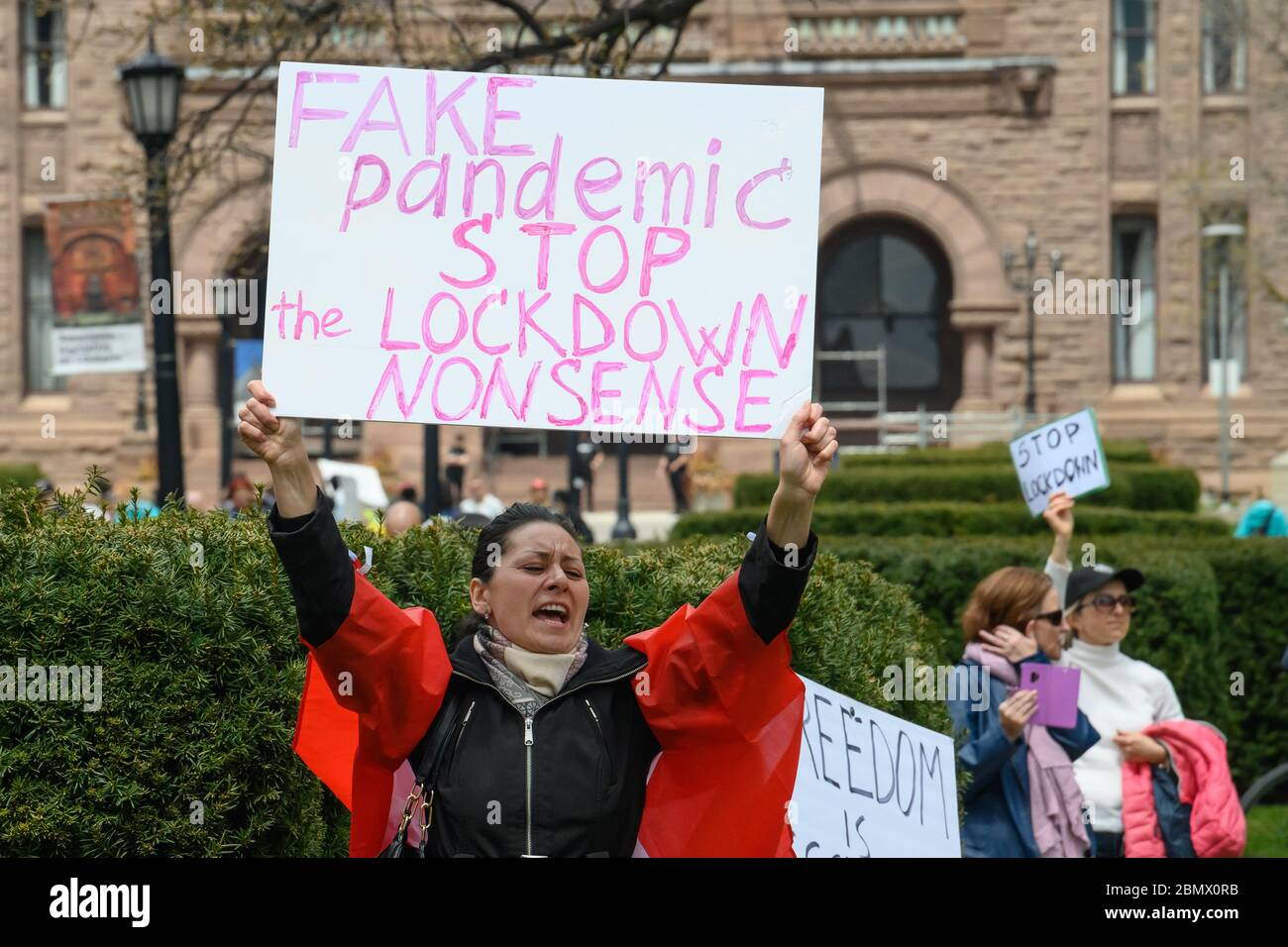 A protester calls for an end to the COVID-19 shutdown outside of the Ontario Legislative Building at Queen's Park, Toronto ON on May 2, 2020. Stock Photo