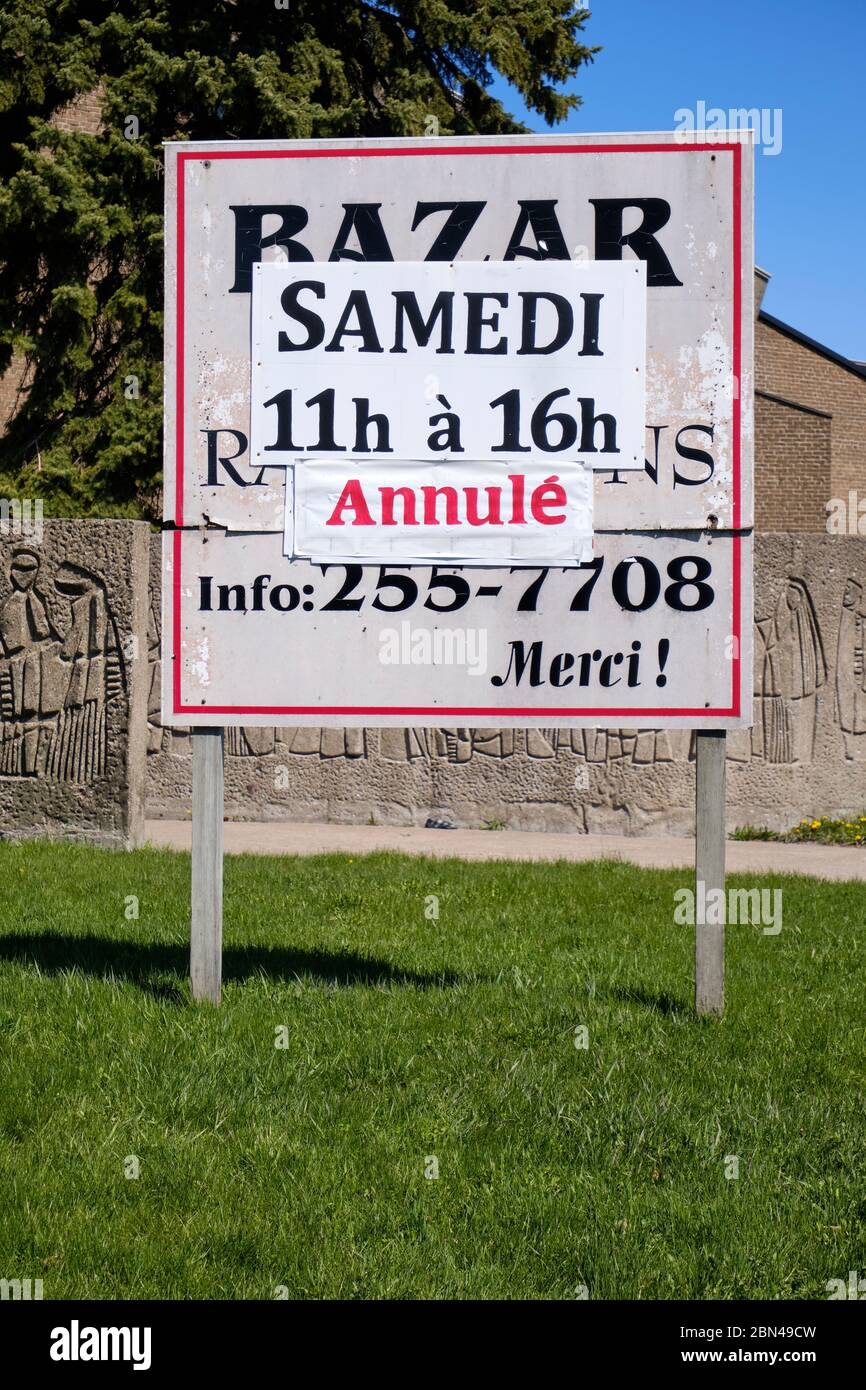 cancelled-sign-outside-church-bazaar-in-east-end-of-montreal-during-covid-19-lockdown-2BN49CW.jpg