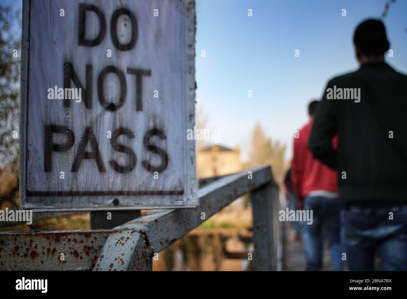 a-do-not-pass-sign-on-a-decaying-bridge-