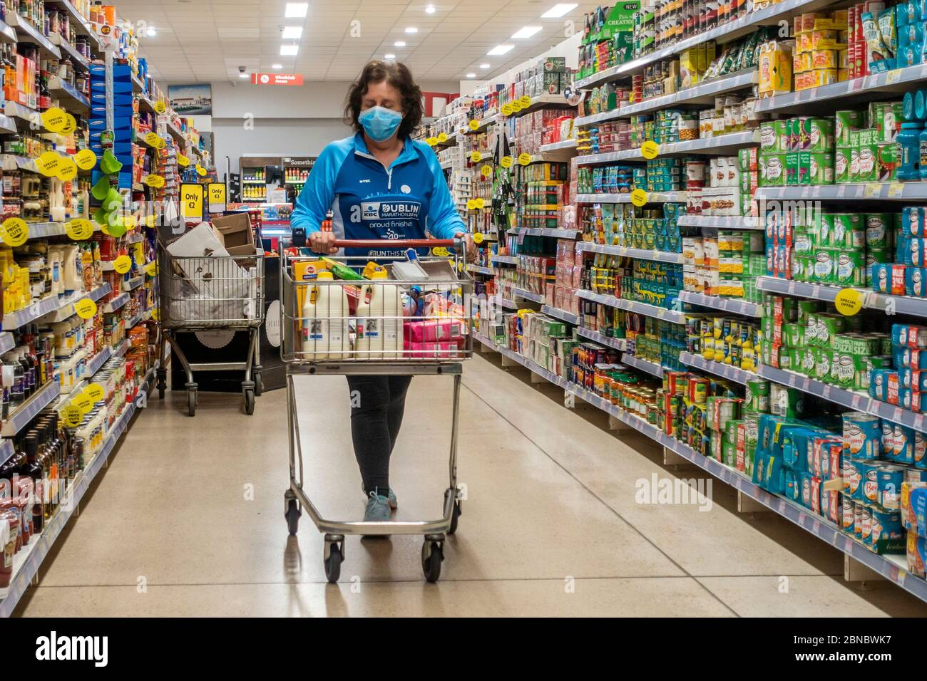 clonakilty-west-cork-ireland-14th-may-2020-a-woman-wears-a-face-mask-to-protect-herself-from-covid-19-as-she-shops-in-supervalu-clonakilty-credit-ag-newsalamy-live-news-2BNBWK7.jpg