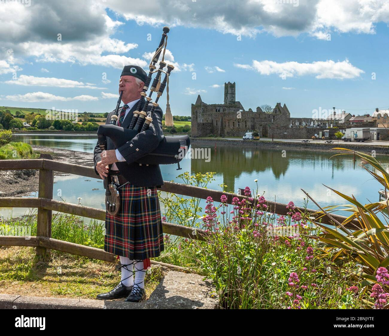 timoleague-west-cork-ireland-15th-may-2020-local-man-michael-heaney-from-timoleague-plays-the-bagpipes-with-timoleague-abbey-in-the-background-mr-heaney-was-filmed-playing-the-pipes-as-part-of-arigideen-rangers-gaa-clubs-fundraising-initiative-the-gaa-club-is-raising-money-for-clonakilty-community-hospital-pieta-house-and-timoleague-parish-church-credit-ag-newsalamy-live-news-2BNJYTE.jpg