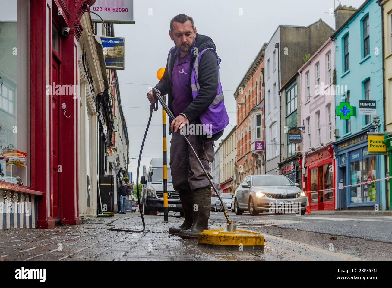 bandon-west-cork-ireland-18th-may-2020-bandon-had-its-main-street-deep-cleaned-this-morning-as-part-of-the-return-to-business-phase-of-exiting-the-covid-19-lockdown-soft-clean-group-was-tasked-with-performing-the-task-in-bandon-marcin-urbaniak-an-employee-soft-cleans-the-street-credit-ag-newsalamy-live-news-2BP857N.jpg