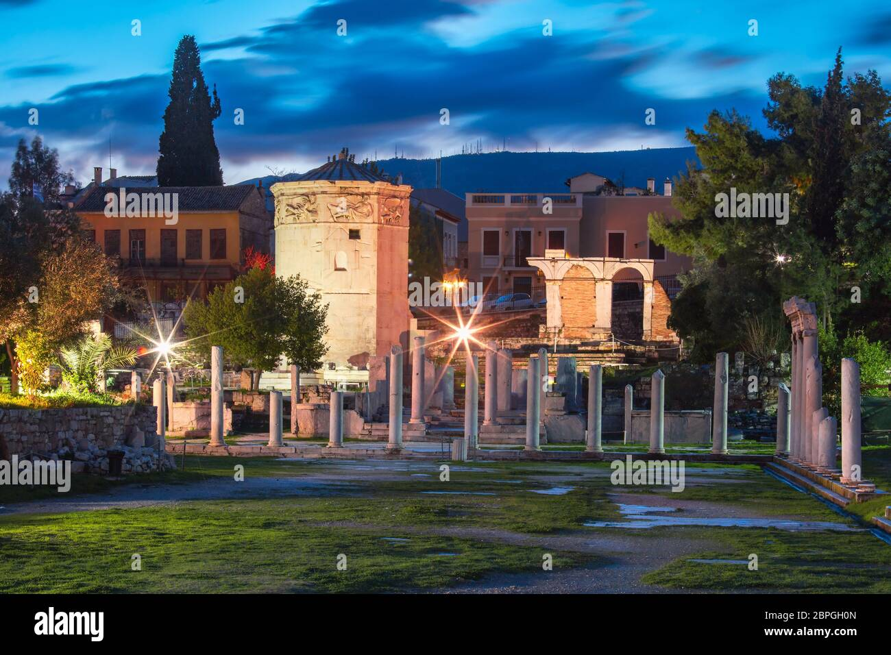 The Tower of the Winds, the world's first meteorological station, an octagonal marble clocktower in the Roman Agora, Athens, Greece Stock Photo