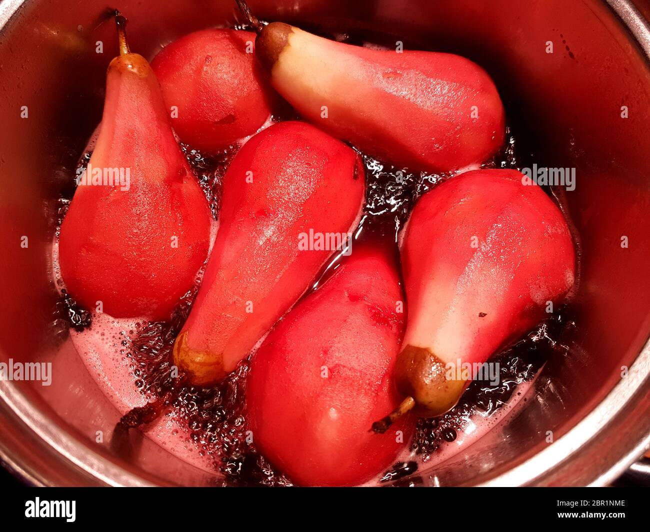 Preparation of poached pears in red wine recipe, one of sequence of 12 images Stock Photo