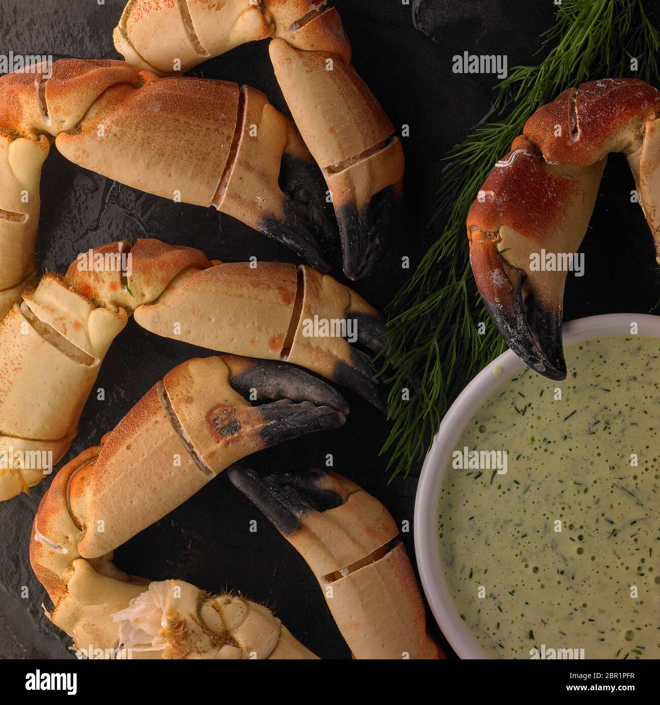 Boiled crab claws with dill cream mayonnaise Stock Photo