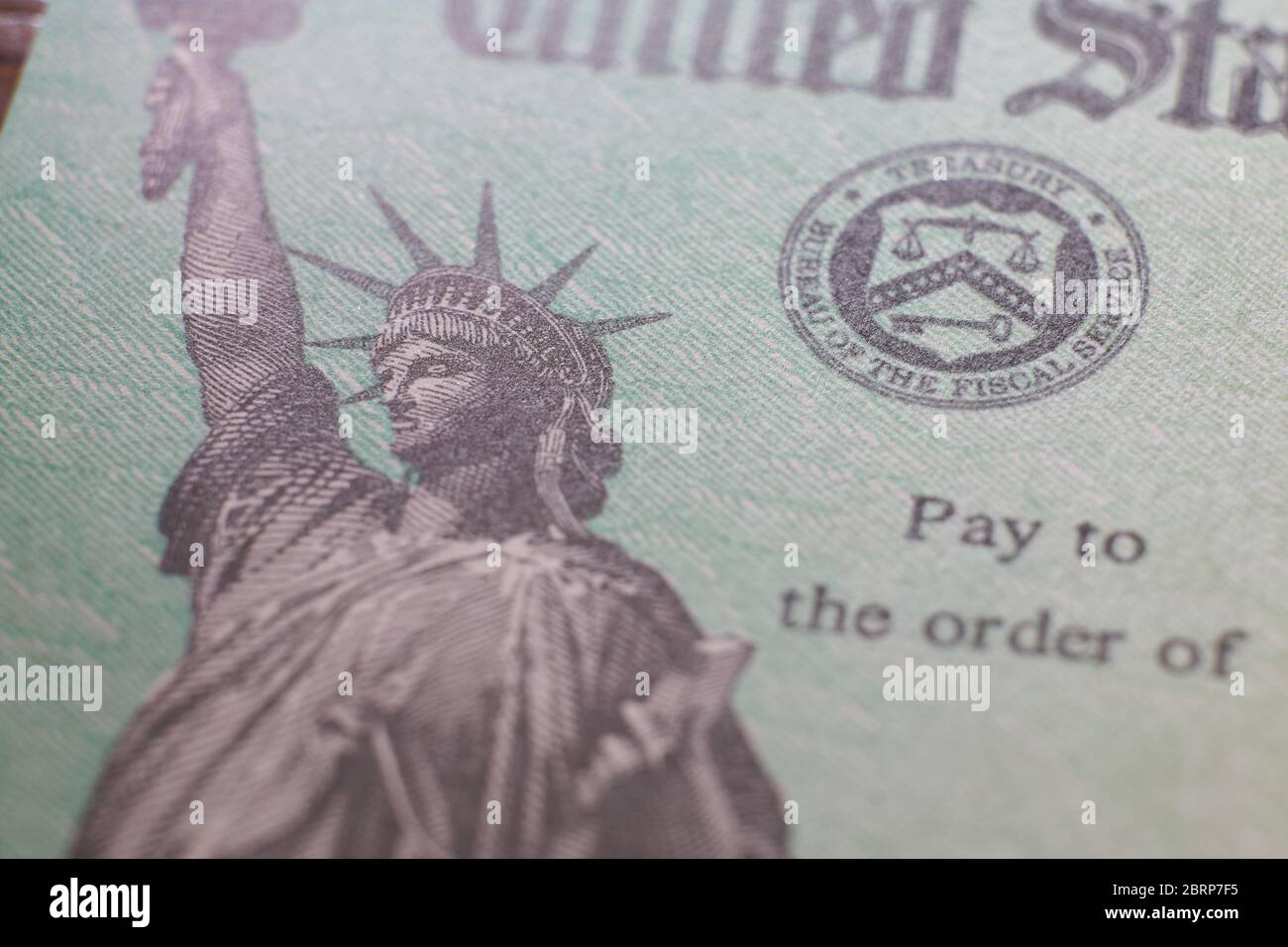text-and-statue-of-liberty-logo-on-the-economic-impact-payment-relief-from-covid-19-pandemic-cheque-check-from-the-us-treasury-2BRP7F5.jpg
