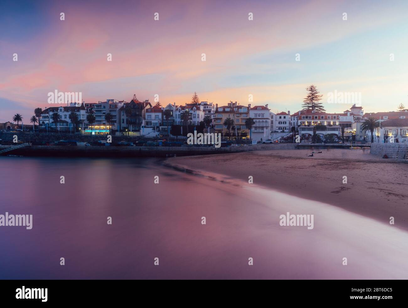 magenta-sunset-overlooking-the-bay-and-historic-centre-of-cascais-portugal-2BT6DC5.jpg