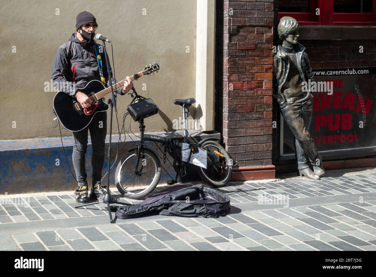 a-busker-with-a-protective-face-mask-on-
