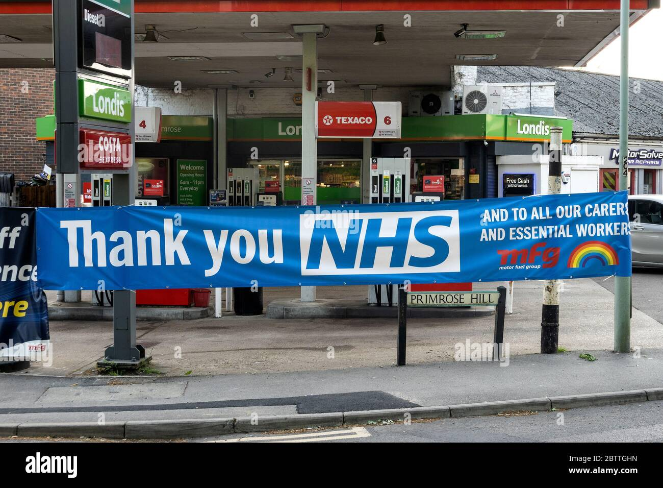 kings-langley-uk-filling-station-displaying-large-thank-you-nhs-banner-a-tribute-and-thanks-to-the-nhs-carers-and-essential-workers-during-the-coronavirus-pandemic-lockdown-and-fight-against-covid-19-supplied-by-the-motor-fuel-group-credit-stephen-bellalamy-2BTTGHN.jpg