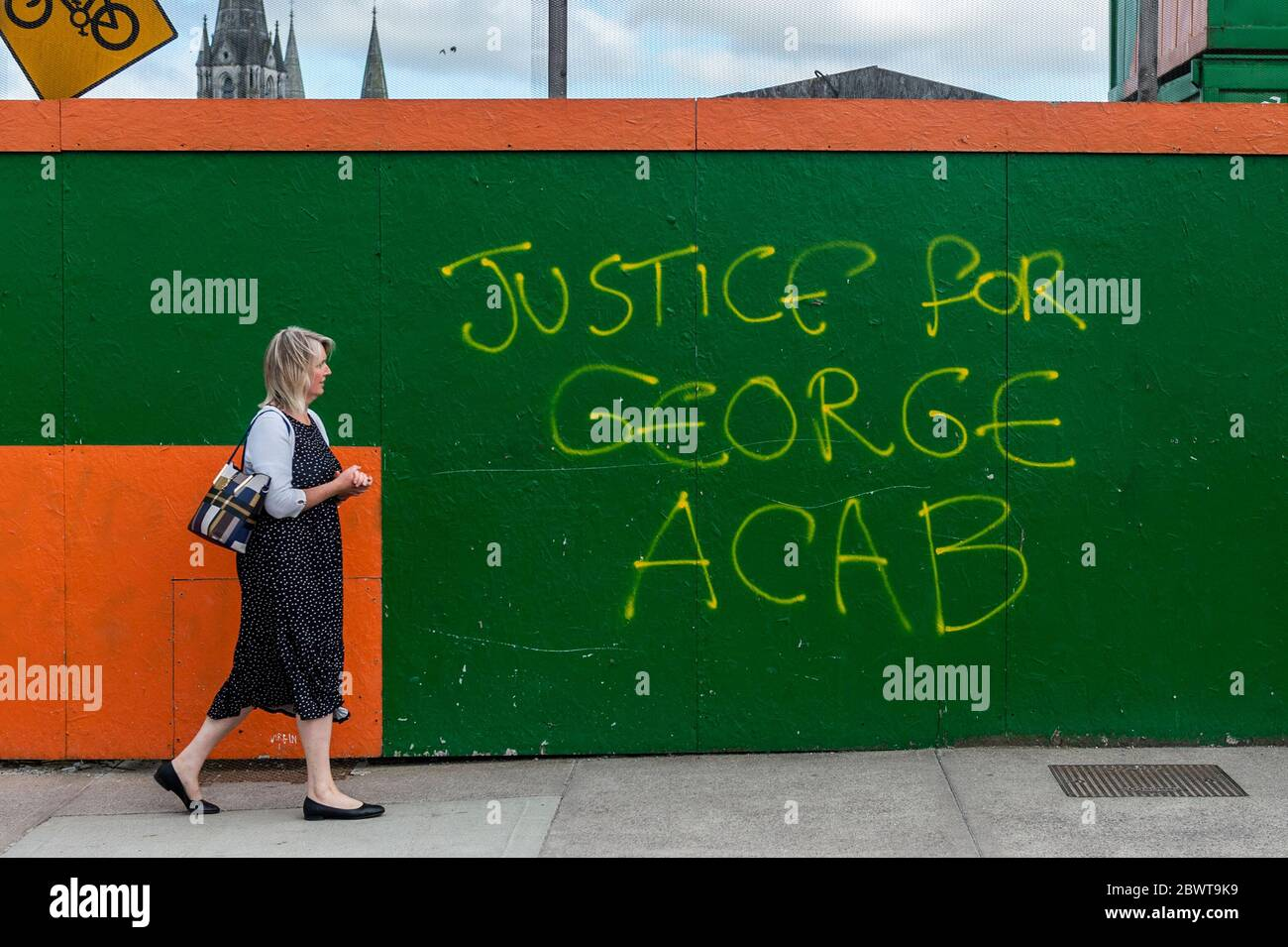 cork-ireland-3rd-june-2020-a-woman-walks-past-george-floyd-graffiti-in-cork-city-the-graffiti-is-in-protest-at-the-killing-of-george-floyd-an-unarmed-black-man-who-was-murdered-by-police-in-minnesota-last-week-credit-ag-newsalamy-live-news-2BWT9K9.jpg