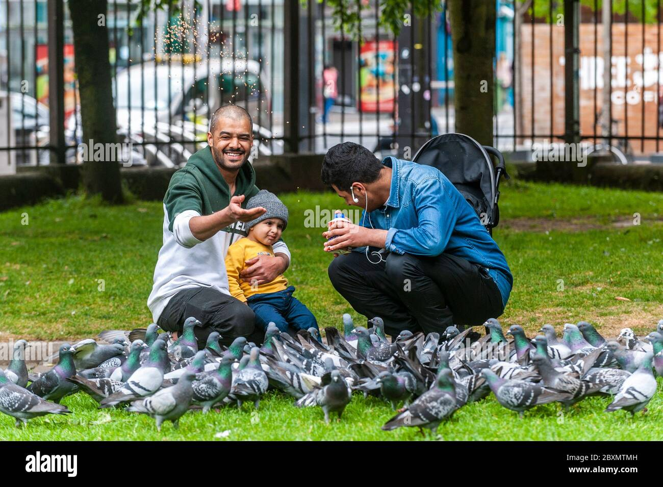 cork-ireland-8th-june-2020-many-shops-in-ireland-are-re-opening-today-after-a-3-month-closure-due-to-the-covid-19-pandemic-a-family-feeds-the-pigeons-in-bishop-lucey-park-grand-parade-cork-credit-ag-newsalamy-live-news-2BXMTMH.jpg