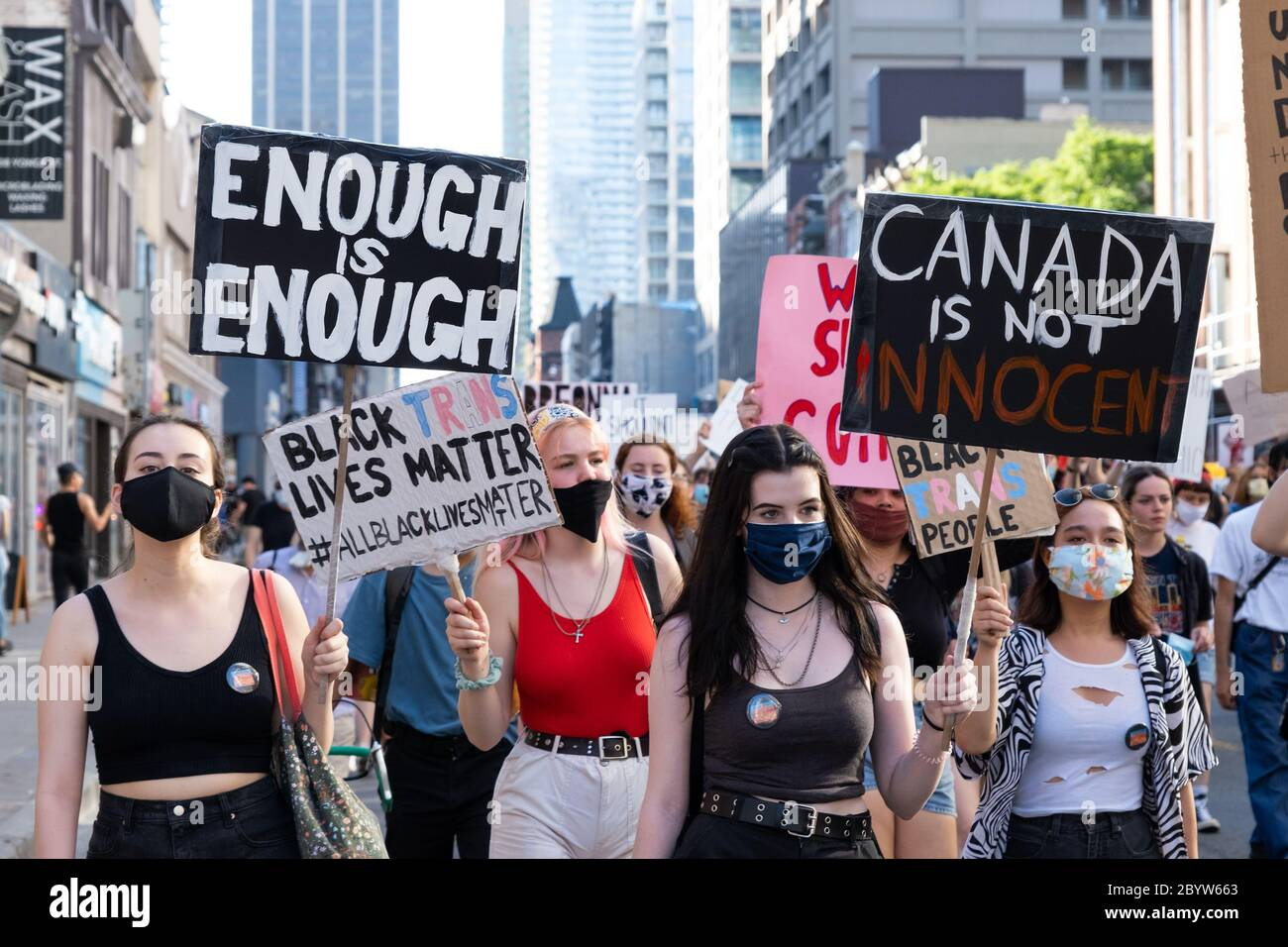 Protesters march in support of Black Lives Matter in Toronto, Ontario, criticizing Canada's history and drawing attention to trans lives as well. Stock Photo