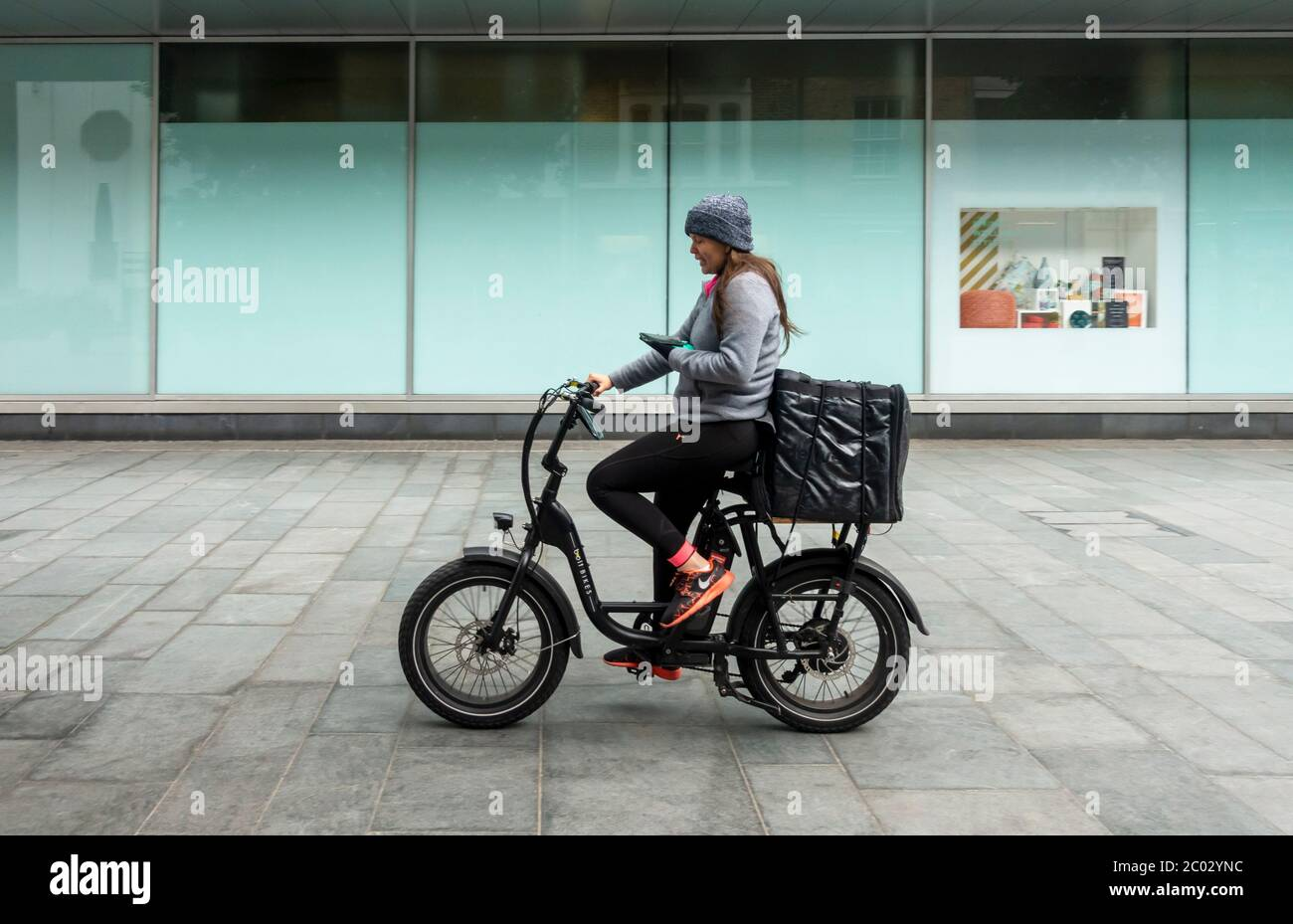 a-young-woman-doing-bicycle-food-deliver