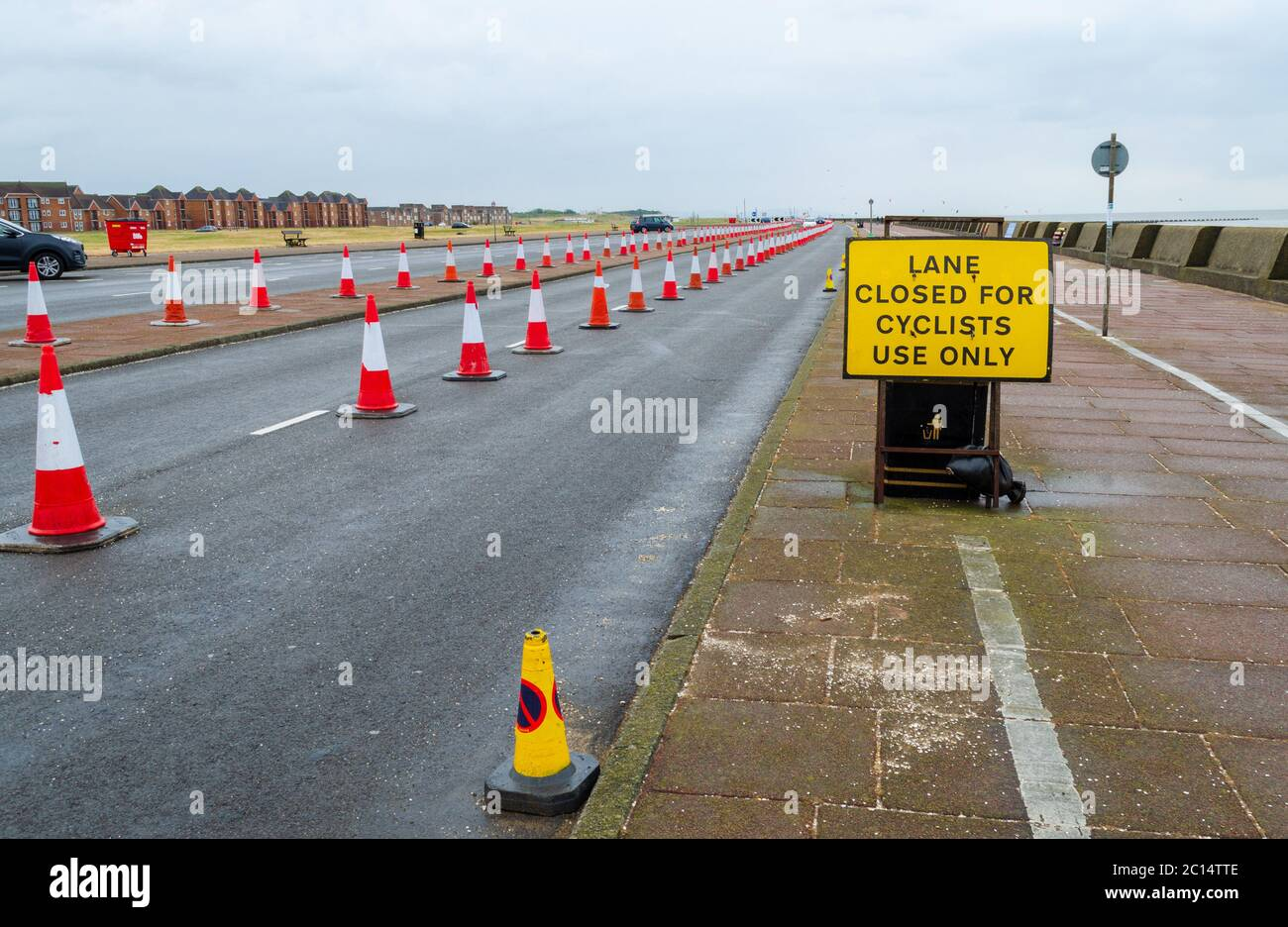 New Brighton, UK: Jun 11, 2020: One lane of the dual carriageway of New Brighton promenade has been closed using traffic cones. This is to allow socia Stock Photo