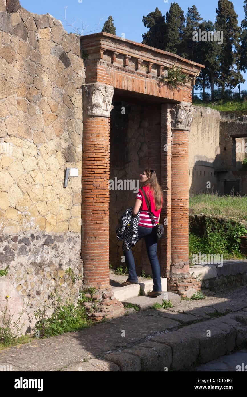 a-tourist-walks-through-the-entrance-to-