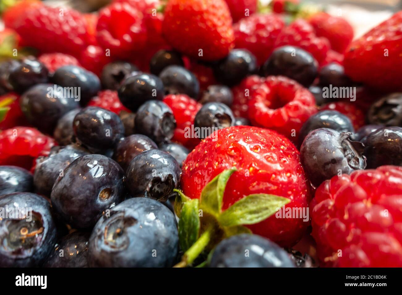 close-up-view-of-soft-summer-fruits-strawberries-raspberries-and-blueberries-2C1BD6K.jpg