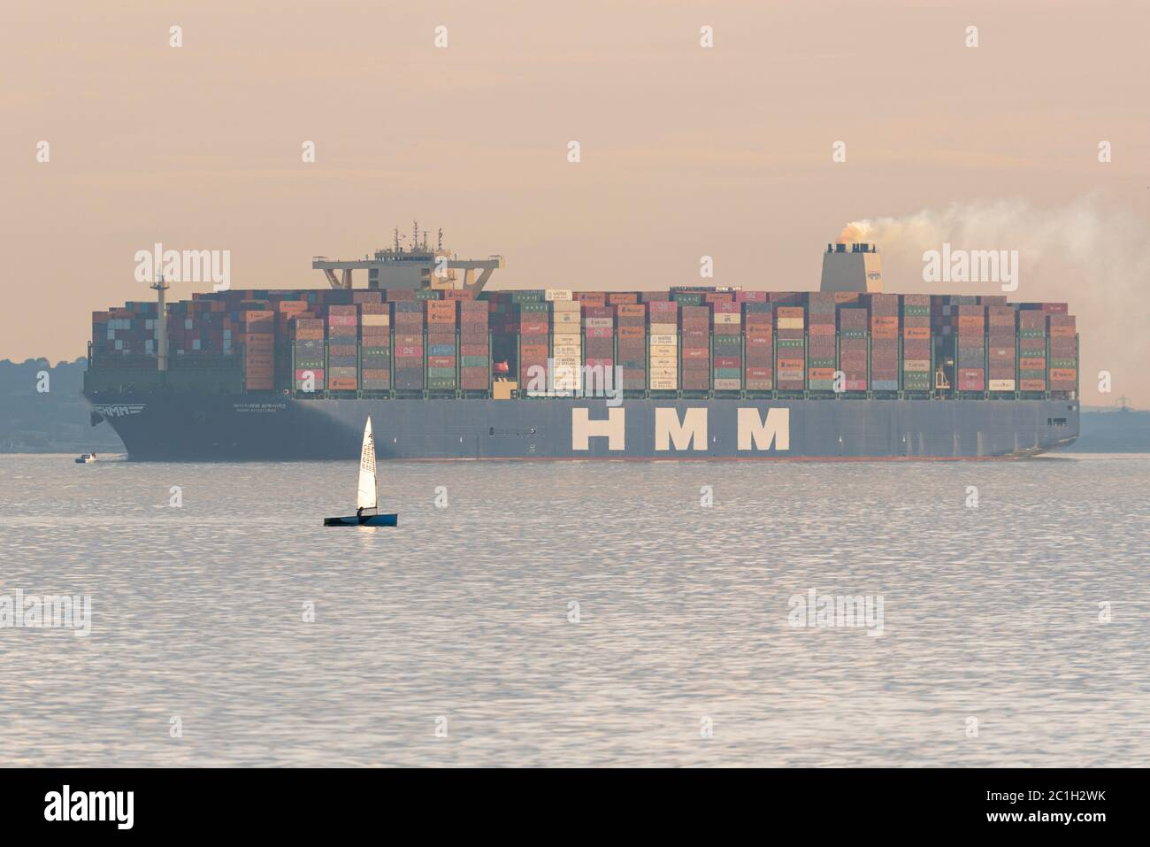 southend-on-sea-essex-uk-15th-jun-2020-hyundai-merchant-marine-hmm-algeciras-is-seen-in-the-evening-passing-southend-on-sea-in-the-thames-estuary-having-departed-dp-world-london-gateway-port-bound-for-the-north-sea-the-algeciras-is-the-largest-container-ship-ever-built-and-arrived-in-the-uk-on-its-first-visit-since-launch-with-goods-from-the-far-east-via-european-ports-such-routes-will-be-its-regular-trade-2C1H2WK.jpg