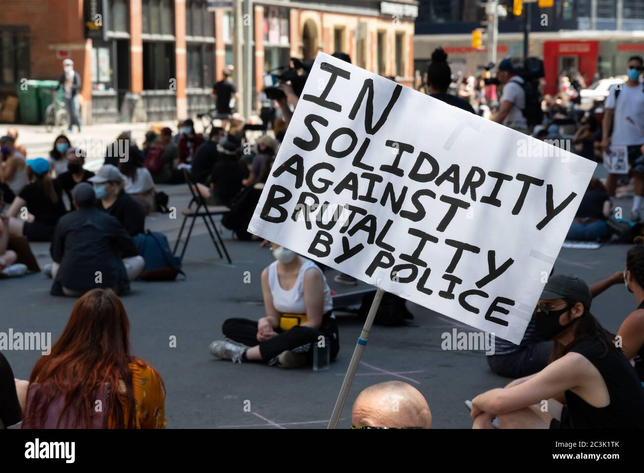 """Protesters join in solidarity against police brutality at a """"Not Another Black Life"""" protest in Toronto, Ontario. Stock Photo"""