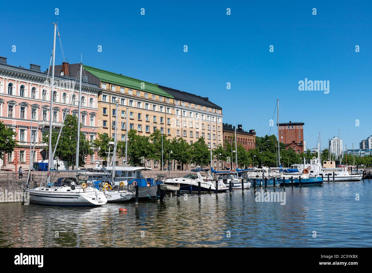 Moored boats and residential buildings of Pohjoisranta in Kruununhaka district of Helsinki, Finland Stock Photo