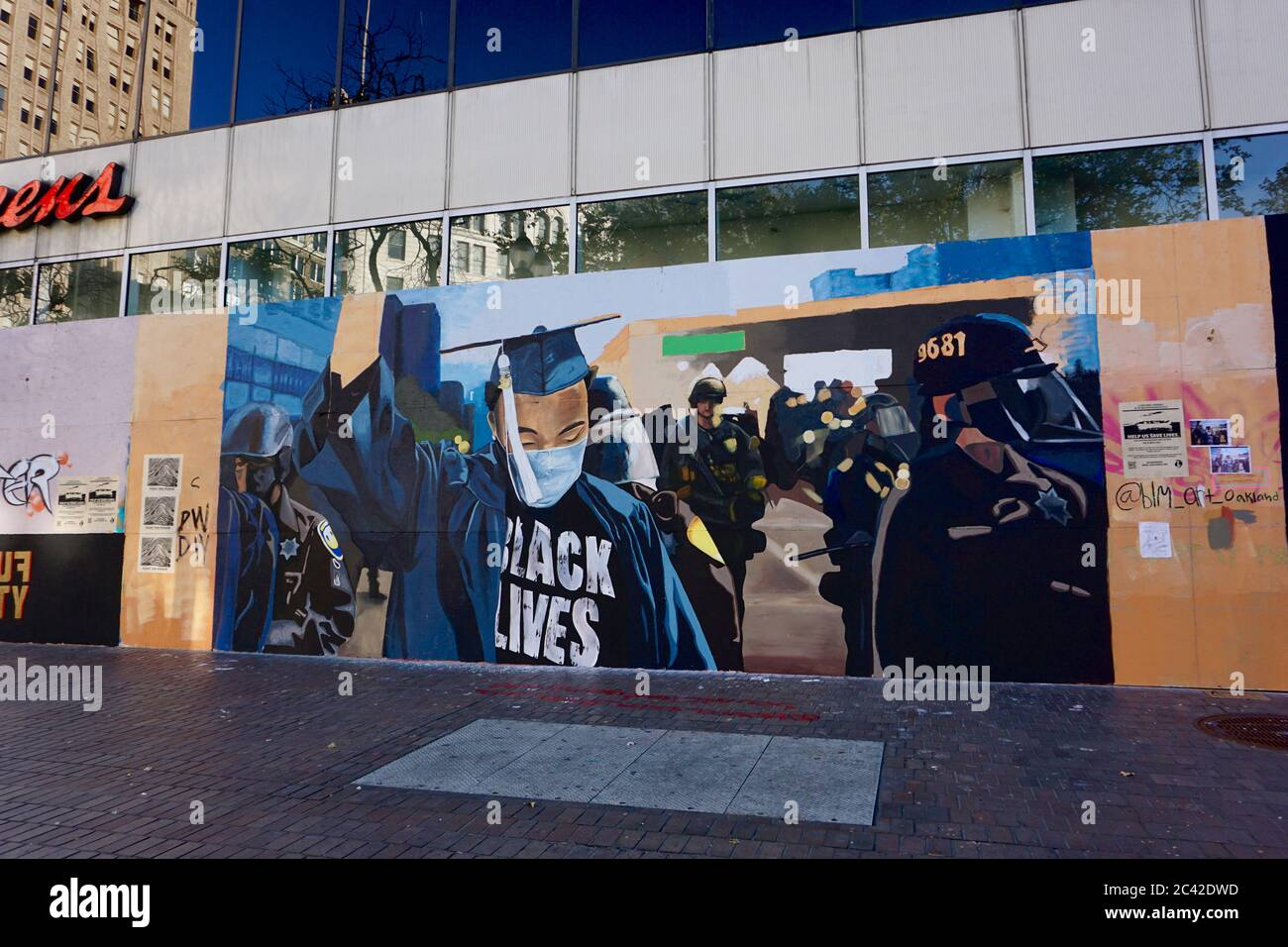 Black Lives Matter protest street art on boarded up buildings after the killing of George Floyd and subsequent looting of Downtown Oakland. Stock Photo