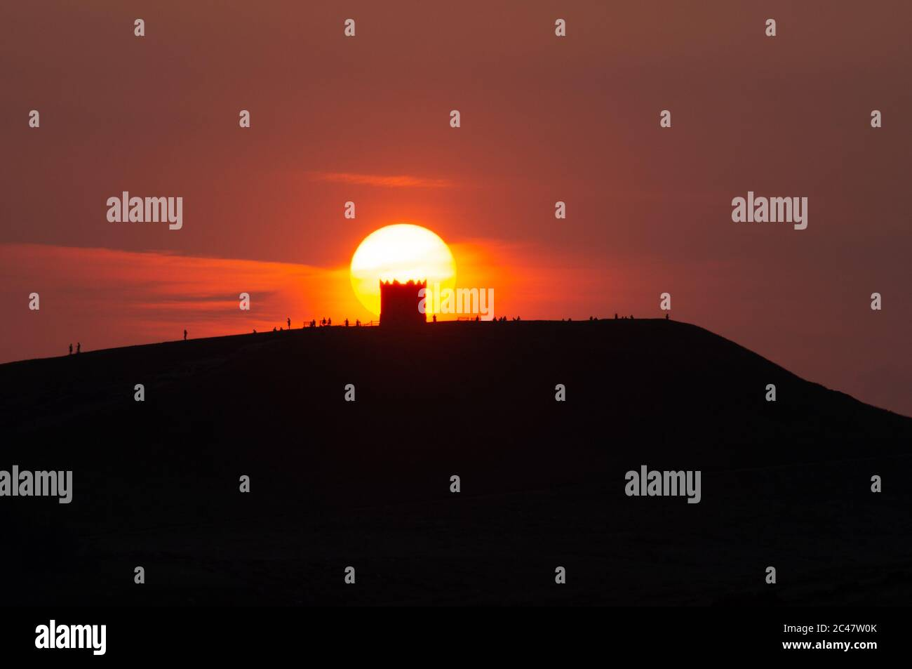Sunset over Rivington Pike Tower, taken from Winter Hill, West Pennine Moors Lancashire England UK Stock Photo