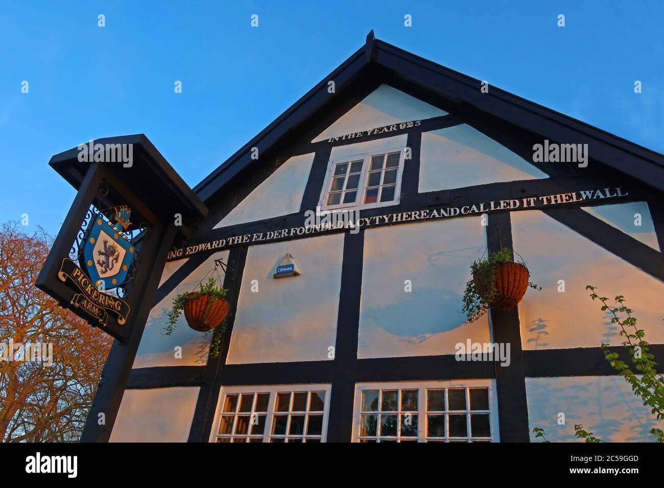 sign,inscription,The Pick,GoTonySmith,HotpixUK,@HotpixUk,evening,village,Cheshire Villages,923,Year 923,timber frame,Tudor,building,historic,Bell Lane,Cheshire,WA4,bar,side,timbered,listed building,public house,sunset,warm,16th,century,18th,inn,gable end,17th century,letters,writing,history,pub sign,shield,crest of arms