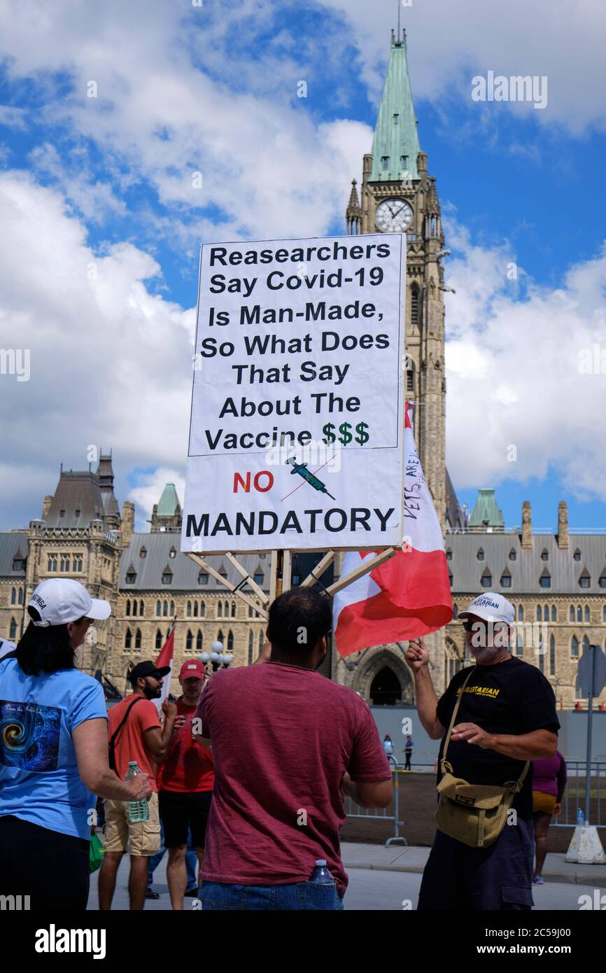 Ottawa, Canada. July 1st, 2020. Covid 19 conspiracy sign from a participant of a  crowd of a few hundreds rallied in front of the Canadian Parliament on Canada day to show their displeasure with the Trudeau government. The complaints ranged from a variety of subjects but mainly focus on the current Covid 19 crisis. Credit: meanderingemu/Alamy Live News Stock Photo