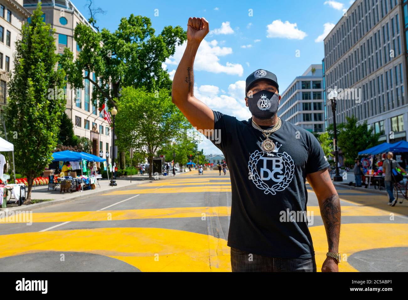 usa-washington-dc-black-lives-matter-plaza-after-the-george-floyd-protests-for-racial-injustice-rapper-grafh-with-raised-fist-wearing-a-mask-2C5ABP1.jpg