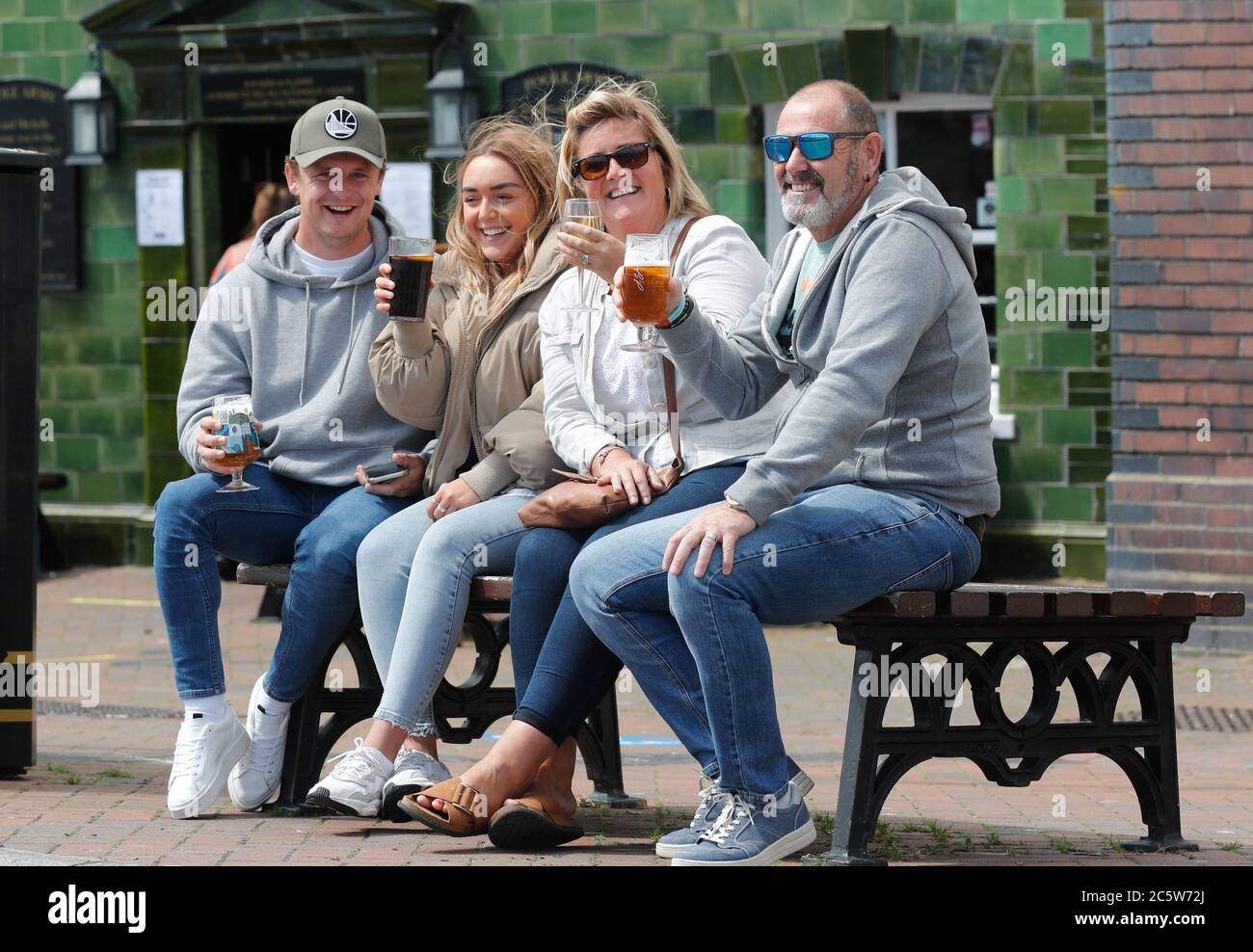 Poole, UK. 5th July 2020. The Critchell family enjoy their first pint out  at the Poole Arms on a bustling Poole Quay  as cafes and pubs reopened this weekend . Credit: Richard Crease/Alamy Live News Stock Photo
