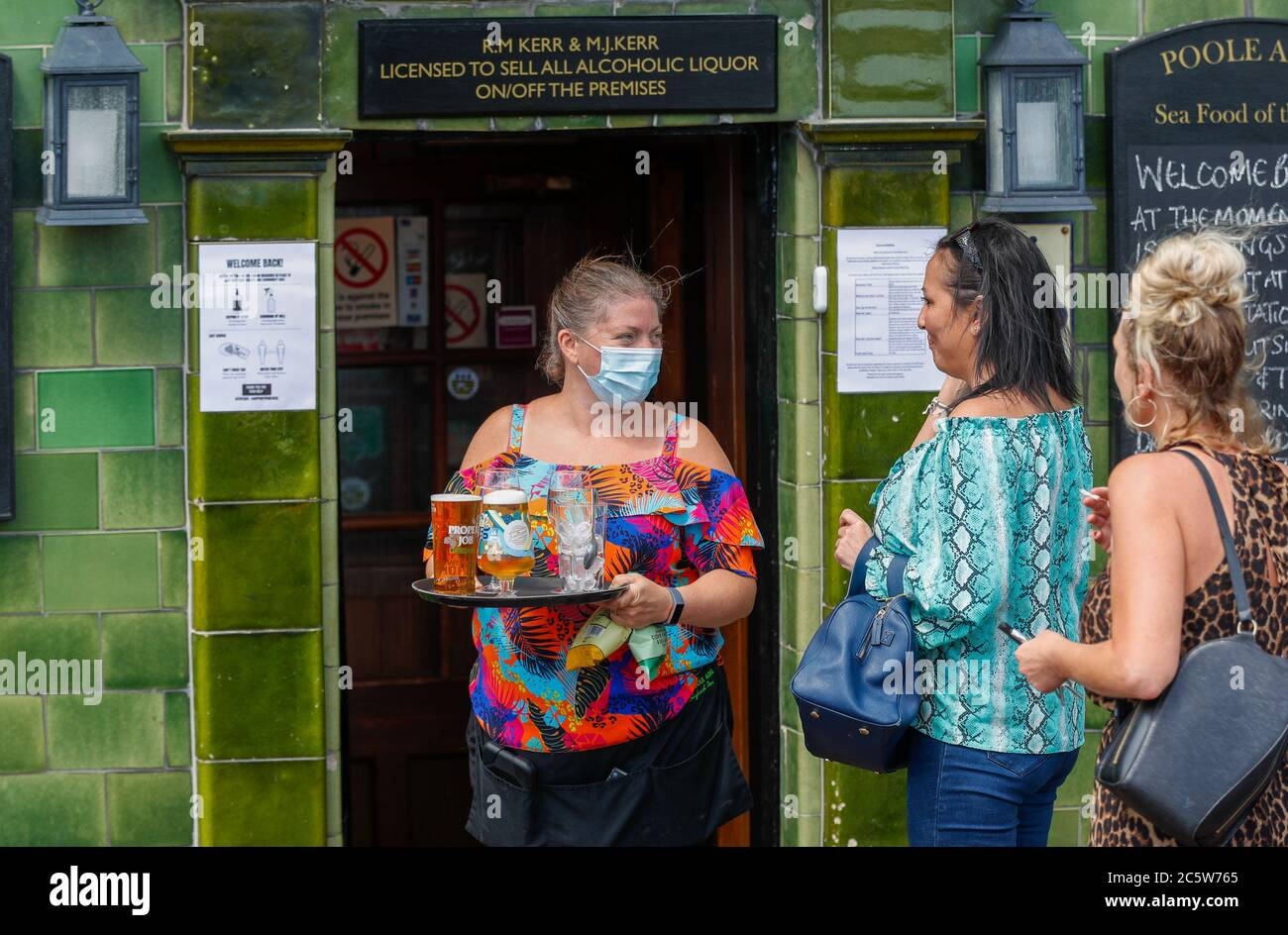 Poole, UK. 5th July 2020. Michelle Kerr, landlady at the Poole Arms on a bustling Poole Quay, Dorset as cafes and pubs reopened this weekend . Credit: Richard Crease/Alamy Live News Stock Photo