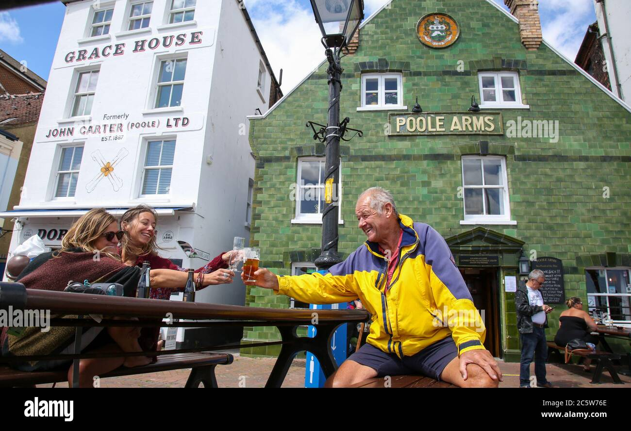 Poole, UK. 5th July 2020. Jim Adams enjoys his  pint  at the Poole Arms on a bustling Poole Quay as cafes and pubs reopened this weekend . Credit: Richard Crease/Alamy Live News Stock Photo