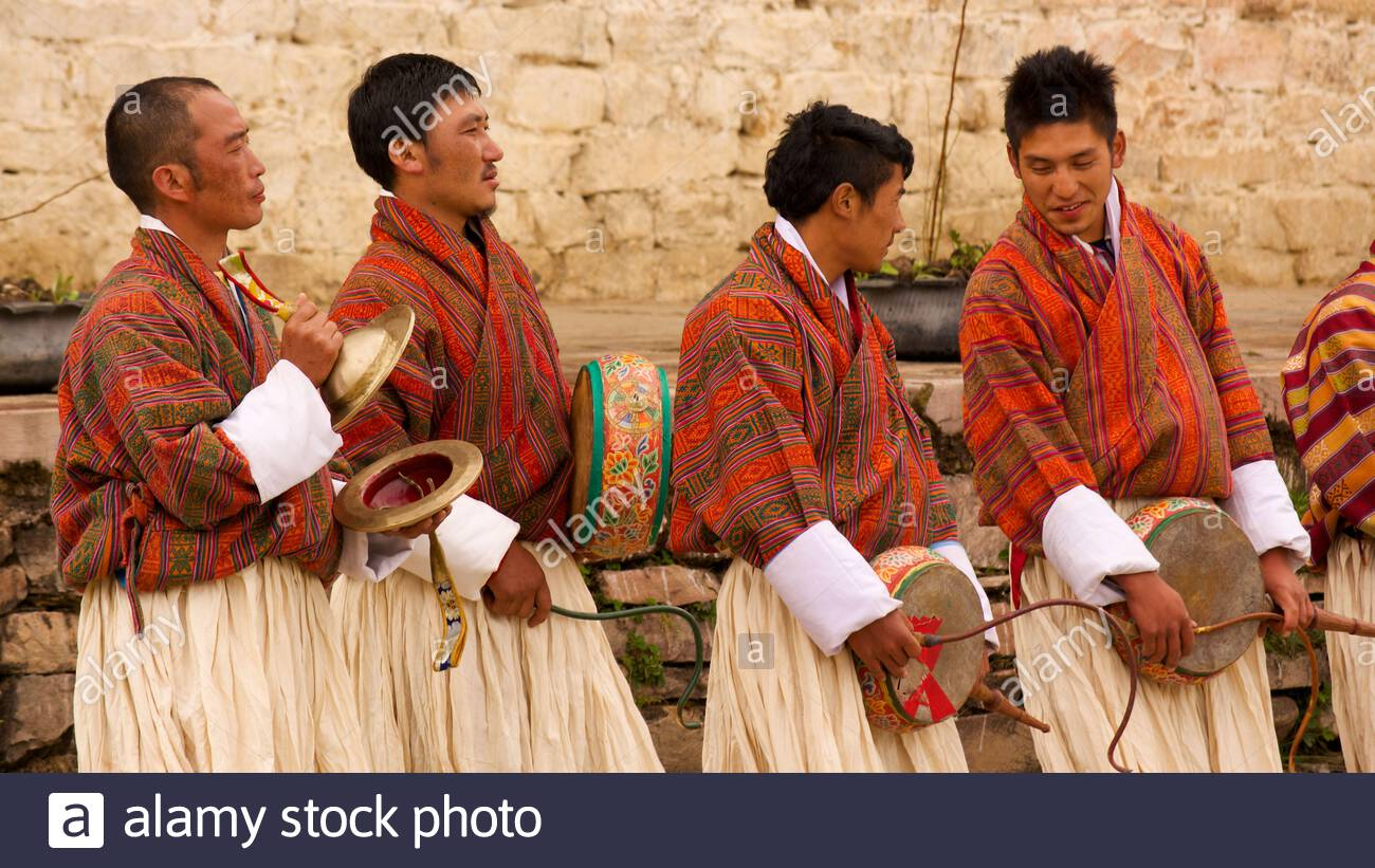 men-waiting-to-perform-their-traditional-dances-with-percussion-instruments-at-the-ura-yakchoe-a-festival-held-in-the-village-of-ura-in-bhutan-2C66HDW.jpg