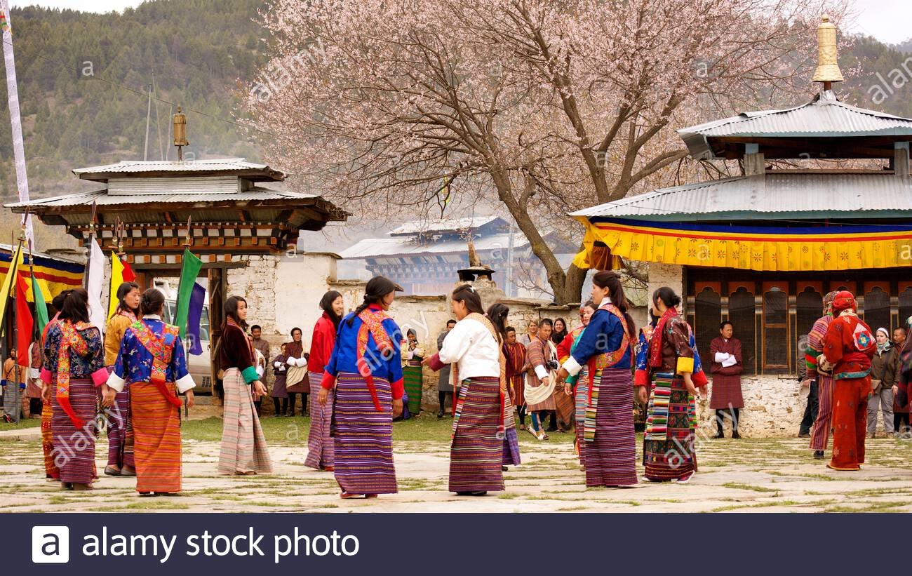 women-singing-and-performing-a-traditional-dance-at-the-ura-yakchoe-a-festival-held-in-the-village-of-ura-in-central-bhutan-2C66HKE.jpg