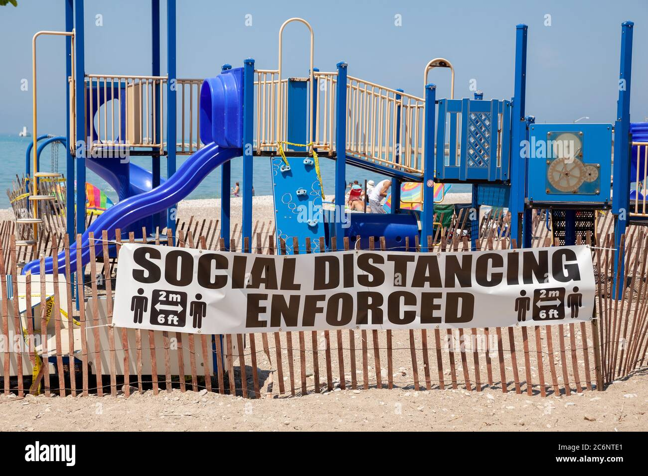 COVID-19 Goderich Ontario Canada Municipal Sign Social Distancing Enforced Posted At The Beach Playground Area Of Town On Lake Huron Stock Photo