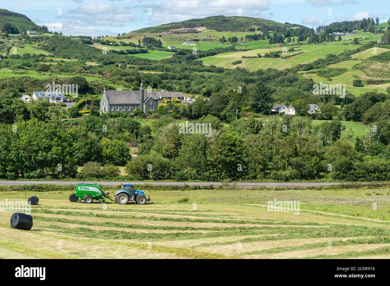 bantry-west-cork-ireland-11th-july-2020-on-a-hot-and-sunny-day-whooley-contractors-make-silage-on-the-farm-of-pat-cadogan-in-aughaville-near-bantry-using-a-new-holland-tractor-and-mchale-fusion-3-plus-baler-credit-ag-newsalamy-live-news-2C6R916.jpg