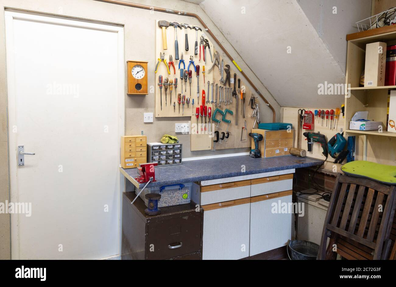 indoor-diy-workshop-and-tools-built-in-a-domestic-garage-during-lockdown-example-of-lockdown-activities-suffolk-england-uk-2C72G3F.jpg
