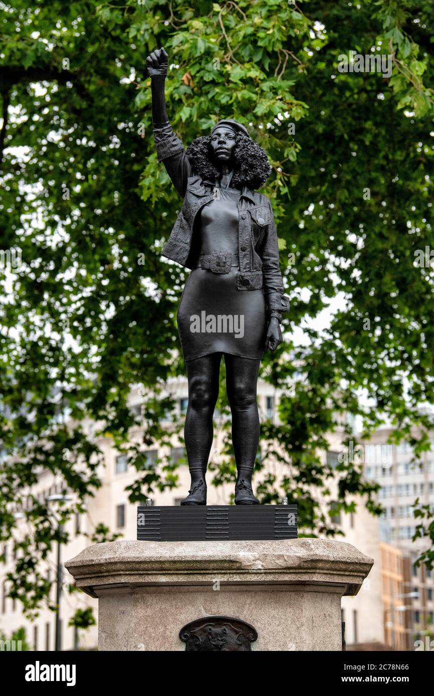 A figure of a Black Lives Matter protester has appeared on the empty plinth previously occupied by the statue of slave trader Edward Colston. Stock Photo