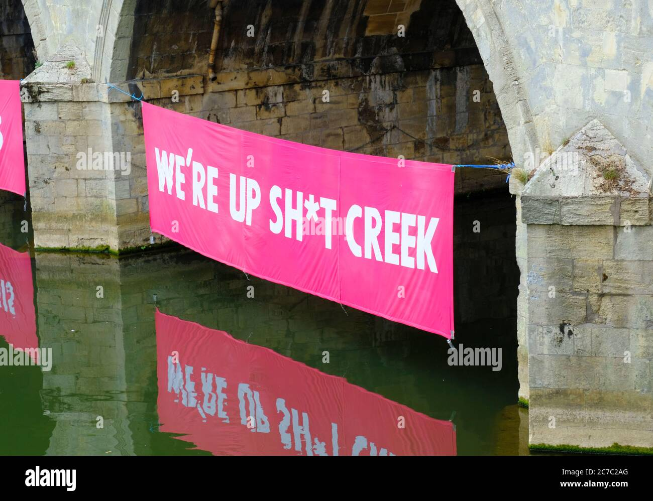 bath-16th-july-2020-climate-change-protestors-extinction-rebellion-have-placed-banners-under-the-arches-of-historic-pulteney-bridge-on-the-river-avon-in-bath-the-message-conveyed-is-that-we-should-rebuild-after-the-corona-virus-pandemic-in-a-green-manner-which-is-sympathetic-to-the-environment-credit-jmf-newsalamy-live-news-2C7C2AG.jpg